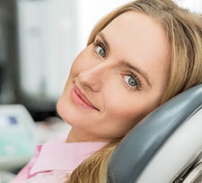 Woman sitting in a dental chair